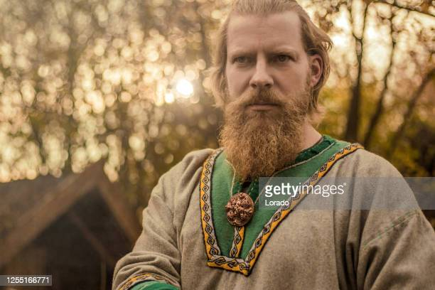 an individual viking man in a viking village settlement - scandinavian ethnicity stock pictures, royalty-free photos & images