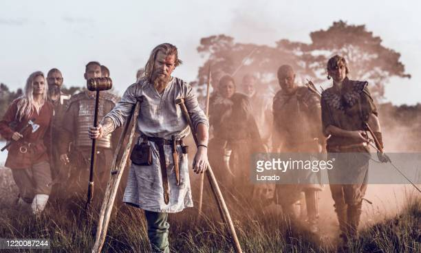 an individual viking warrior jarl outdoors with his guards - historical clothing stock pictures, royalty-free photos & images