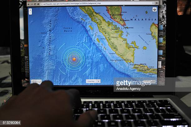 An Indonesia man read news of the earthquake that shook the Mentawai islands on the internet that just happened in Jakarta Indonesia on March 02 2016...