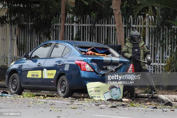 An Indonesian anti-bomb unit collects evidences after a bomb exploded in Makassar on March 28, 2021.