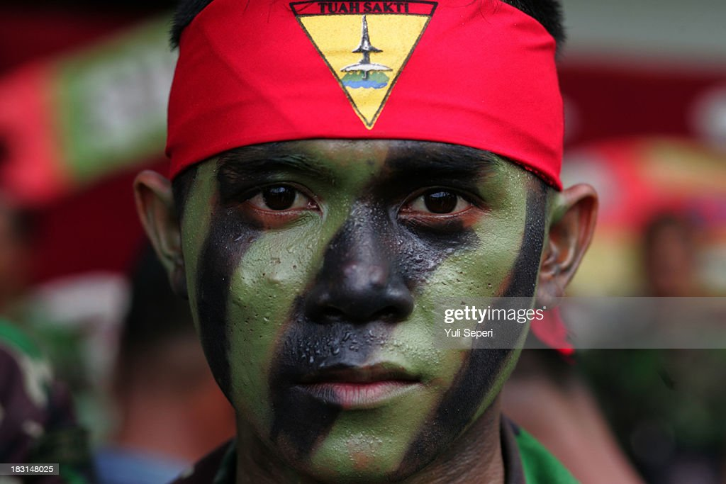 An Indonesian Army soldier poses for a portrait during the 68th anniversary commemoration of the Indonesian Military or TNI on October 5, 2013 in Bintan Island, Indonesia. This year's TNI anniversary was organised under the theme 'Professional, Militate, Solid and Strong TNI-people.'