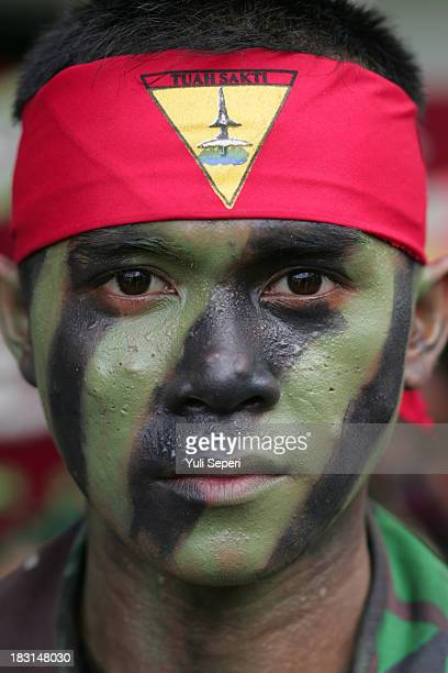 An Indonesian Army soldier poses for a portrait during the 68th anniversary commemoration of the Indonesian Military or TNI on October 5, 2013 in...