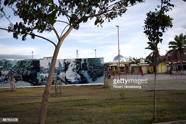 An Indonesian billboard portraying the military's achievements stands in a city park in Aceh province's capital city June 15 2009 Following the...