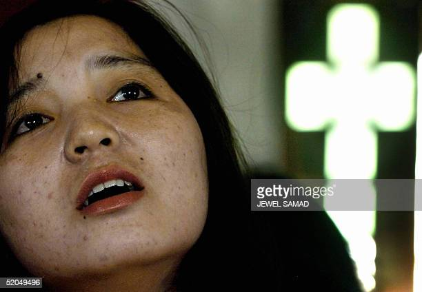 An Indonesian Christans tsunami disaster survivor prays at a church in Banda Aceh 23 January 2005 As hundreds of thousands of psychologicallyscarred...