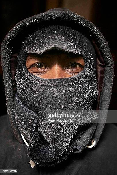 An Indonesian crew member wears a frost covered balaclava as he works deep in the trawler Ferralemes' refrigerated hold on February 4 2007 in Stanley...