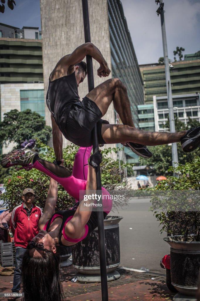 Pole Dancing on the Street of Jakarta