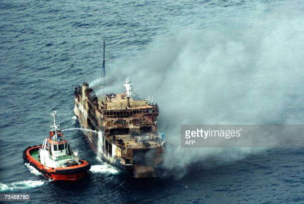 An Indonesian fire fighting ship douses a fire on a ferry north of Jakarta 22 February 2007 At least 15 people were killed when a ferry carrying more...