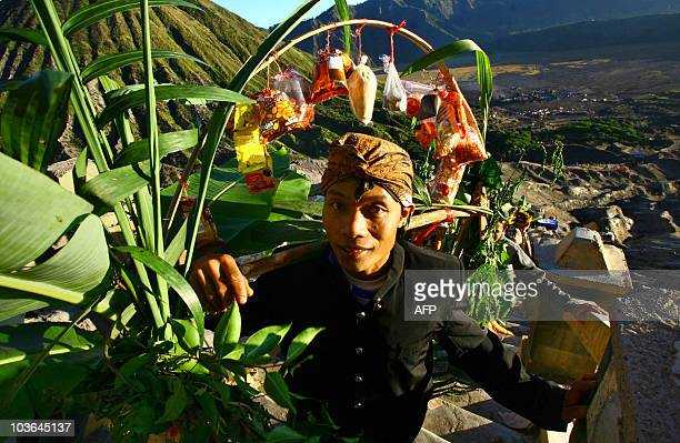 An Indonesian Hindu pilgrim carries an offering at the crater of Mount Bromo in East Java province on August 26 2010 as part of the traditional...