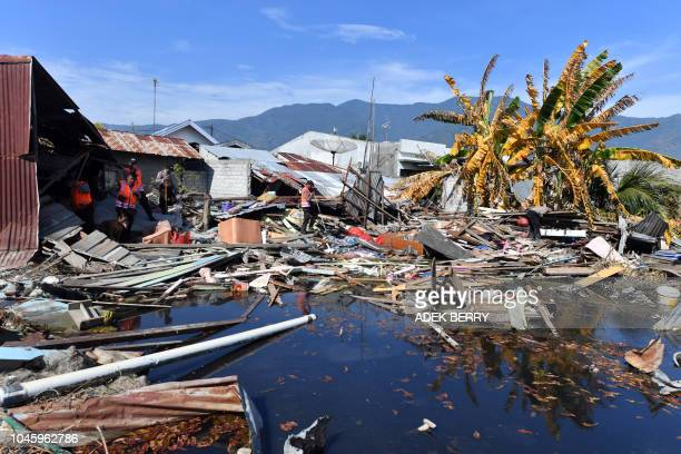 An Indonesian K9 police unit searches for victims in Palu, in Indonesia's Central Sulawesi on October 5 following the September 28 earthquake and...