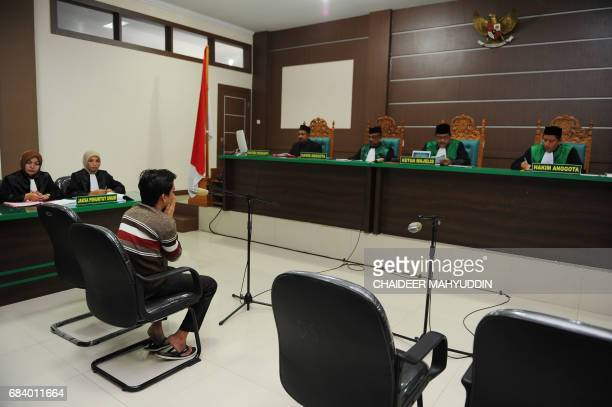 An Indonesian man attends his trial at a shariah court in Banda Aceh on May 17 2017 A sharia court on May 17 sentenced two men to be publicly caned...