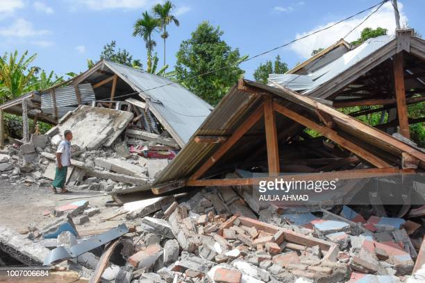 TOPSHOT An Indonesian man examines the remains of houses after a 64 magnitude earthquake struck in Lombok on July 29 2018 A powerful earthquake on...