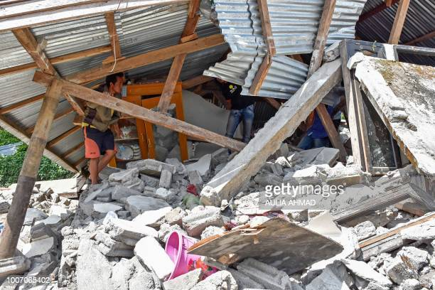 An Indonesian man looks at the remains of a house after a 64 magnitude earthquake struck in Lombok on July 29 2018 A powerful earthquake on the...