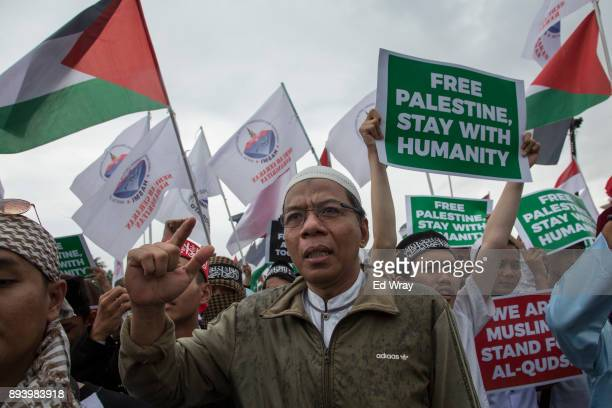 An Indonesian man makes a statement at a large demonstration against the United States' decision to recognize Jerusalem as the Capital of Israel on...