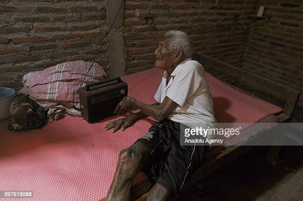 An Indonesian man named Mbah Gotho claimed to be 146 years old is the oldest human in world's history turns on his radio during speaking to press...