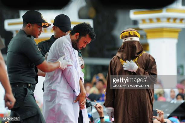 An Indonesian man one of two to be publicly caned for having sex is taken to be caned in Banda Aceh on May 23 2017 The pair aged 20 and 23 were found...
