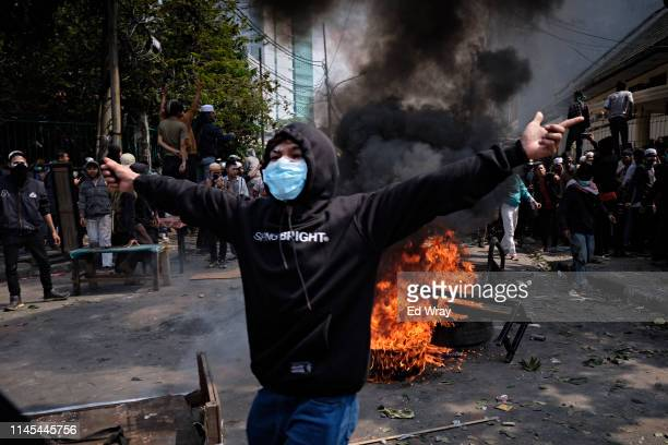 An Indonesian man taunts police during a clash on May 22 2019 in Jakarta Indonesia Indonesian police fired tear gas during clashes between protesters...