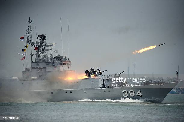 An Indonesian military warship launches missiles during The 69th Republic of Indonesian Military Anniversary on October 7 2014 in Surabaya Indonesia...