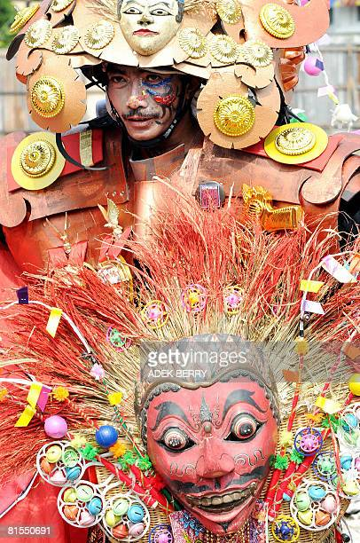 An Indonesian model in costume takes part in the Solo Batik Carnival in the central Java city of Solo on April 13 2008 Hundreds of people...