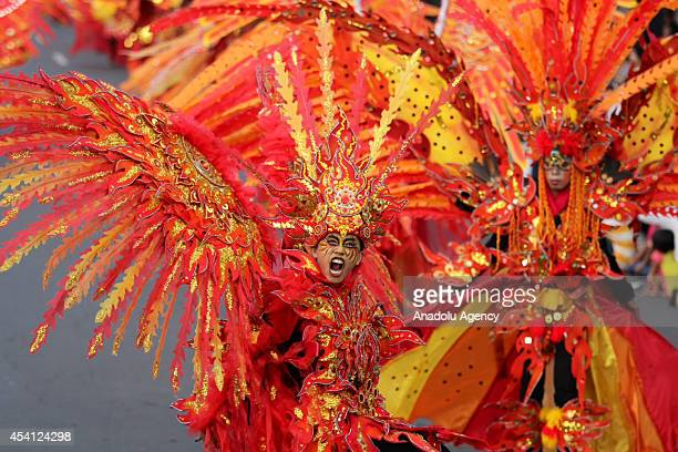 An Indonesian model showcases a design on the catwalk during the 13th Jember Fashion Carnival 2014 in Jember Indonesia on August 24 2014 This years...