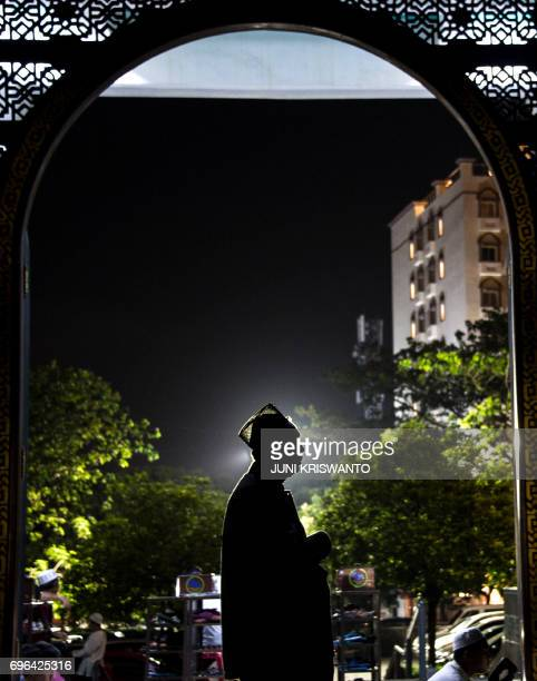 An Indonesian Muslim man offers prayers on the 21st day of holy month of Ramadan at a Al Akbar mosque in Surabaya early on June 16 2017 Muslims...