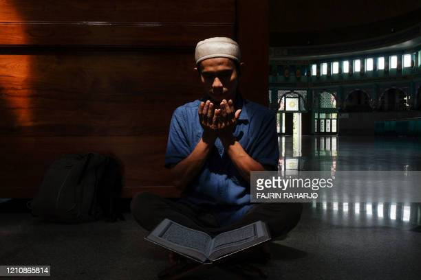 TOPSHOT An Indonesian Muslim prays at a mosque during the first day of a holy month of Ramadan in Tangerang Banten on April 24 2020
