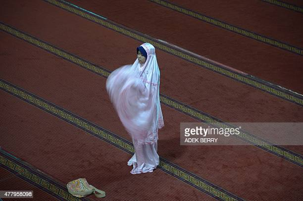 An Indonesian Muslim woman offers prayers during the month of Ramadan at the Istiqlal mosque in Jakarta on June 21 2015 More than 15 billion Muslims...