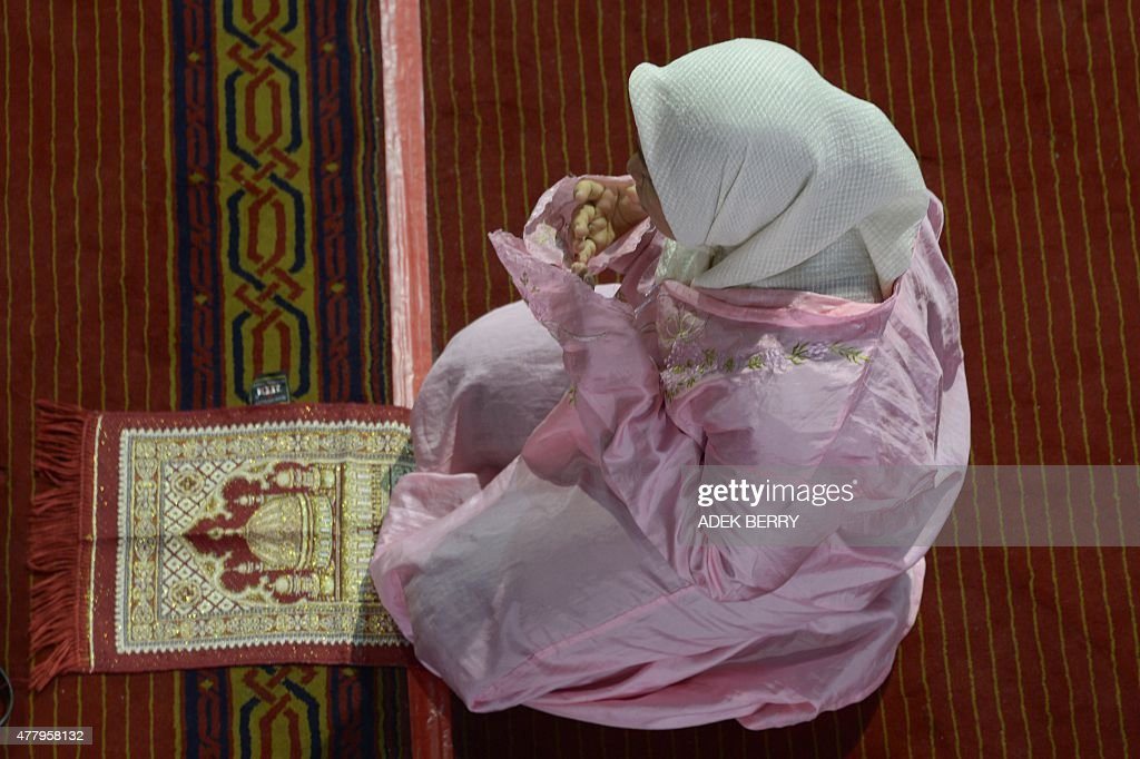 An Indonesian Muslim woman offers prayers during the month of Ramadan at the Istiqlal mosque in Jakarta on June 21, 2015. More than 1.5 billion Muslims around the world celebrate the month with fast from dawn to dusk and conduct night prayers.