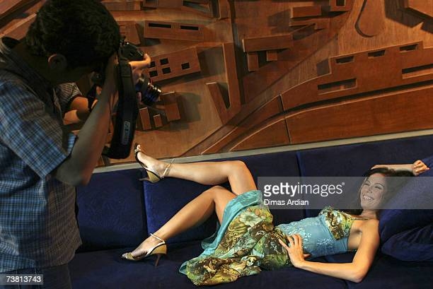 An Indonesian Playboy magazine photographer shoots a model at a photo shoot on April 5 2007 in Jakarta Indonesia Indonesian judges acquited...