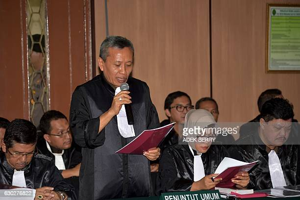 An Indonesian prosecutor reads a document during the trial of Jakarta's Christian governor Basuki Tjahaja Purnama for blasphemy at the North Jakarta...