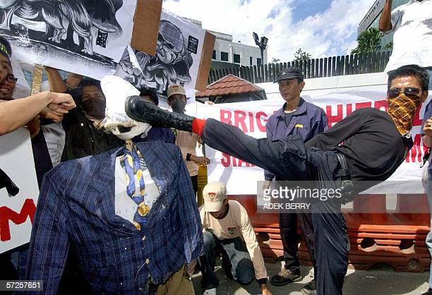 An Indonesian protester kicks an effigy of Australian Prime Minister John Howard during a demonstration in front of the Australian embassy in Jakarta...