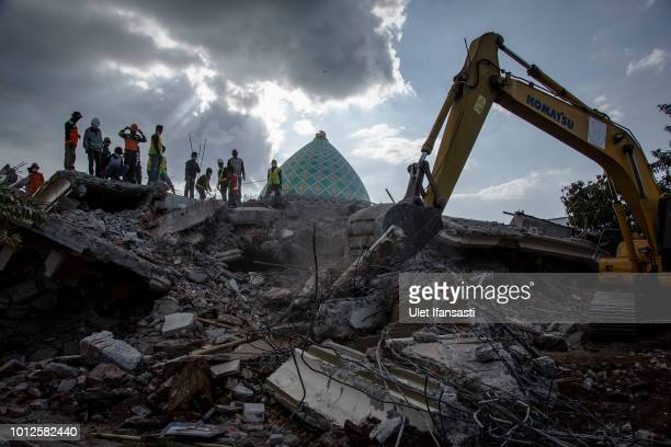 An Indonesian search and rescue team looking for victims at a collapsed mosque following an earthquake in Tanjung on August 7 2018 in Lombok Island...