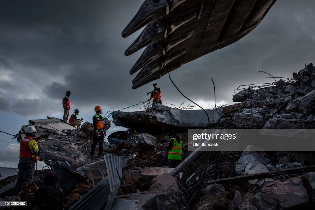 An Indonesian search and rescue team looking for victims at a collapsed mosque following an earthquake in Tanjung on August 7, 2018 in Lombok Island, Indonesia. Nearly 100 people have been confirmed dead after a 6.9-magnitude earthquake hit the Indonesian island, Lombok, and neighbouring Bali which left at least 20,000 people homeless. Based on reports, officials believe that the death toll may rise with aftershocks expected to rattle the area and aid agencies say their priority is to now provide shelter for displaced people.