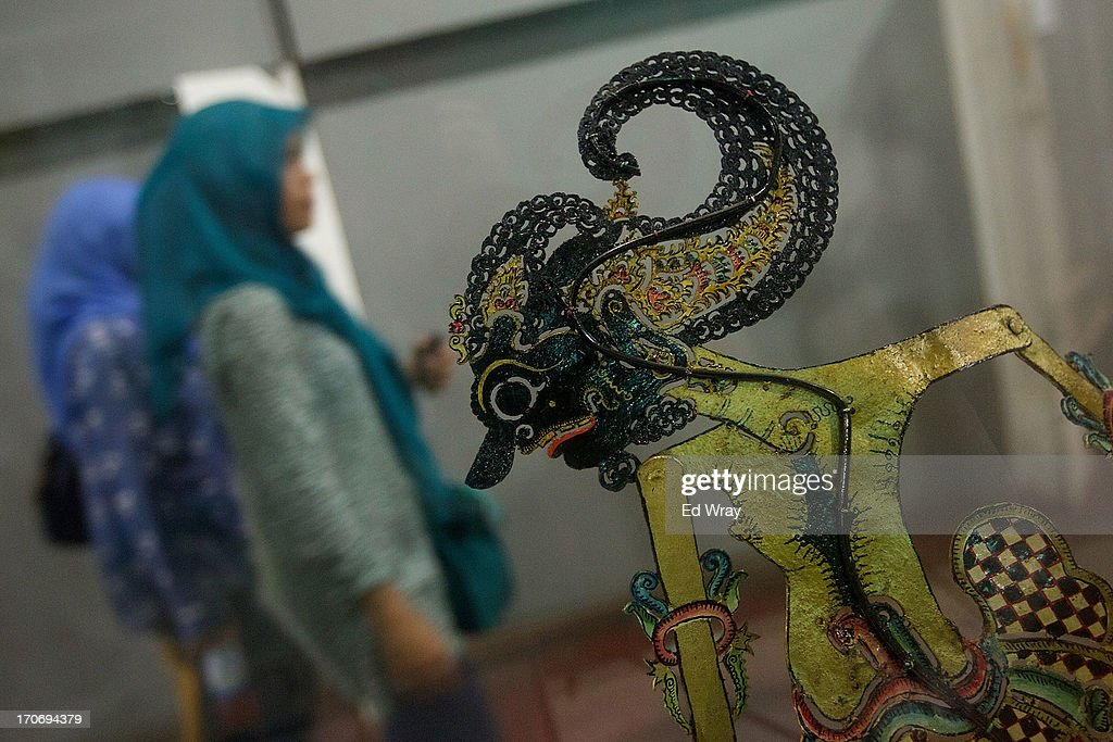 An Indonesian tourist looks over example of wayang puppets at the Wayang museum in Kota Tua Sunday June 16, 2013 in Jakarta, Indonesia. Once known as the 'Queen of the East', Kota Tua, which means Old Town in Indonesian, is the original city of Jakarta built by the Dutch in the 16th century and called Batavia at that time. Currently, Kota Tua's beautiful Colonial architecture is in ruins, abandoned as the city edged farther south over the years. Jakarta's Governor, Joko Widodo, hopes to make it a priority to restore the old town and develop it into a high end tourist destination..
