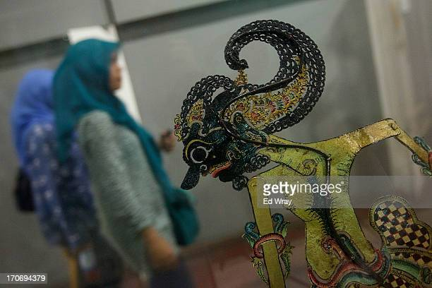 An Indonesian tourist looks over example of wayang puppets at the Wayang museum in Kota Tua Sunday June 16 2013 in Jakarta Indonesia Once known as...