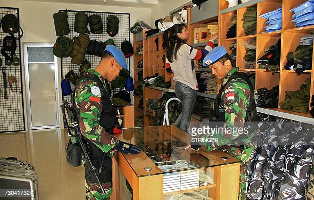 An Indonesian UNIFIL doctor checks equipment at a shop that sells military clothes and gadgets in the southern Lebanese market town of Marjayoun near...