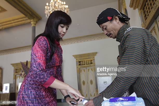 An Indonesian voter inks her finger after casting her ballot during the Indonesia Presidential Plection on July 9 2014 in Yogyakarta Indonesia Two...