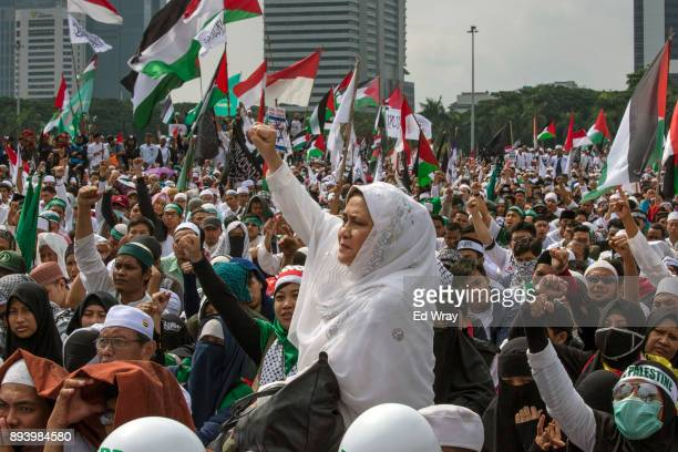An Indonesian woman shouts 'God is great' at a large demonstration against the United States' decision to recognize Jerusalem as the Capital of...