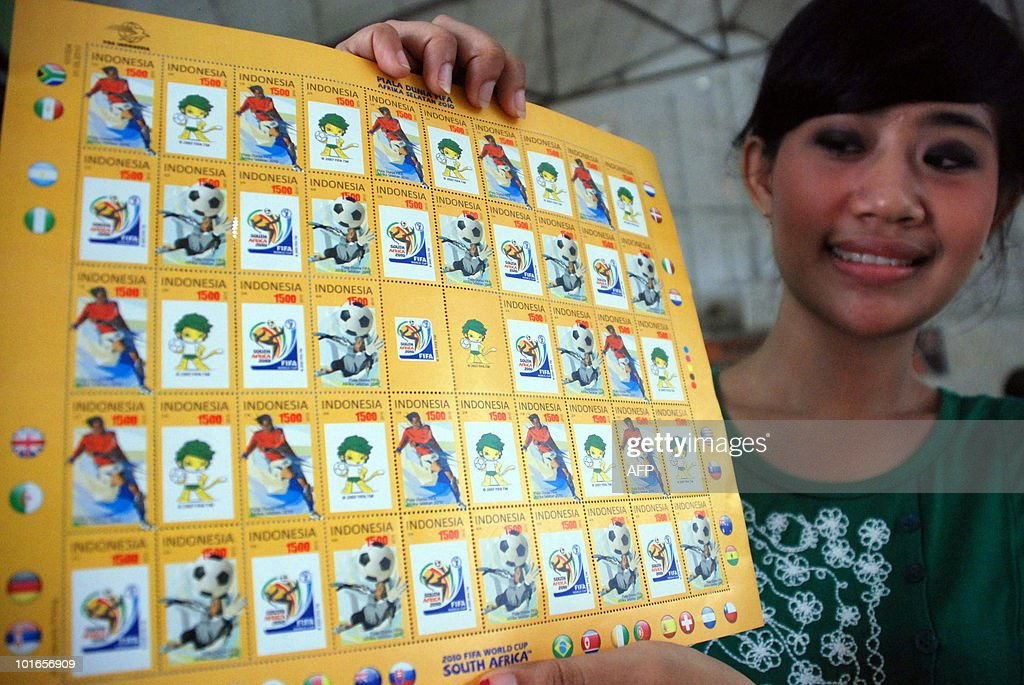 An Indonesian woman shows stamps featuring the World Cup 2010, in Surabaya on June 6, 2010. The 2010 FIFA World Cup will be the 19th FIFA World Cup, is scheduled to take place between 11 June and 11 July 2010 in South Africa.