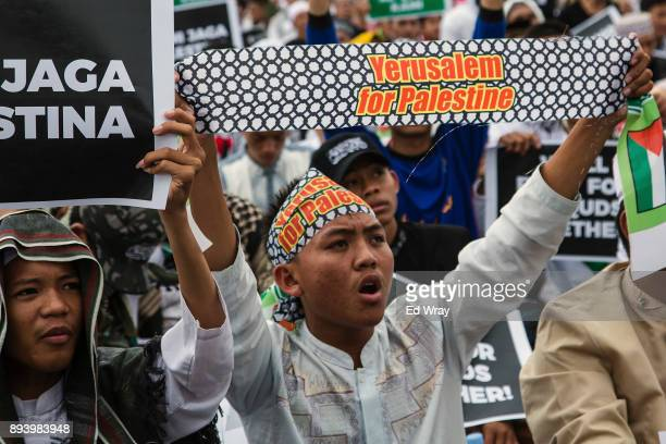 An Indonesian youth holds aloft a proPalestinian banner at a large demonstration against the United States' decision to recognize Jerusalem as the...