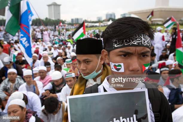 An Indonesian youth participates in a large demonstration against the United States' decision to recognize Jerusalem as the Capital of Israel on...