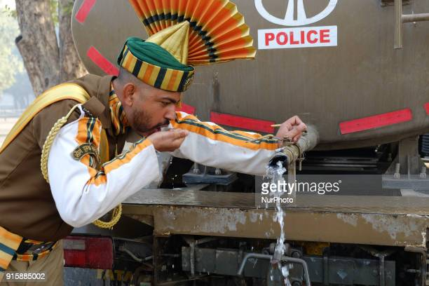 An Indo-Tibetan Border Police soldier drinks water after rehearsing for the upcoming 69th Republic Day Parade in New Delhi on January 13, 2018.
