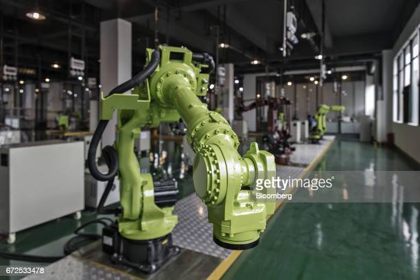 An industrial robot stands at a factory operated by EDeodar Robot Equipment Co a whollyowned subsidiary of Ningbo Techmation Co in Foshan China on...
