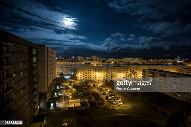 An industrialized apartment block is pictured during moon light on November 19, 2018 in Stendal, Germany.