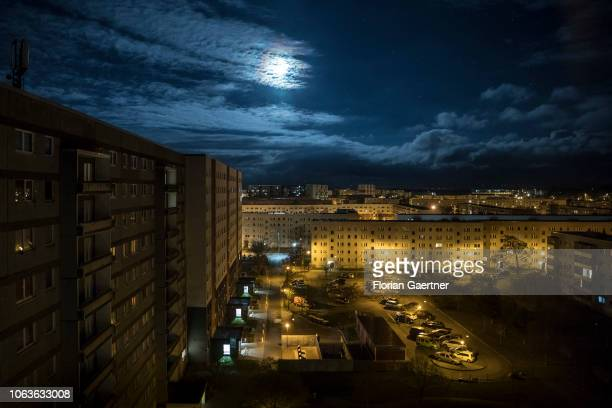 An industrialized apartment block is pictured during moon light on November 19 2018 in Stendal Germany