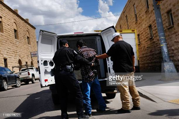 An inebriated man is taken away by police on June 04 2019 in Gallup New Mexico New Mexico is one of the poorest states in the United States with a...