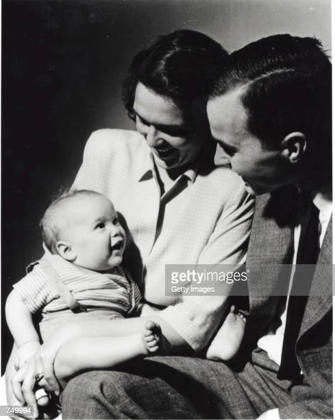 An infant George W Bush with his mother Barbara Bush and his father George Bush posing for a portrait in New Haven CT April 1947 George W Bush is...