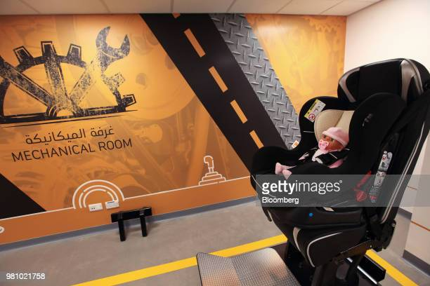 An infant safety seat sits in a training room at the Saudi Aramco driving school for women at the headquarters of the Saudi Arabian Oil Co in Dhahran...