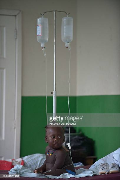 An infant suffering from cholera sits on a bedat the Charles Colimon hospital in Petite Riviere on the Artibonite river believed to be the source of...