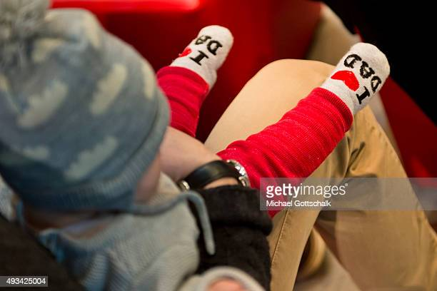 An infant wears socks with the lettering I love dad on October 14 2015 in Frankfurt Germany