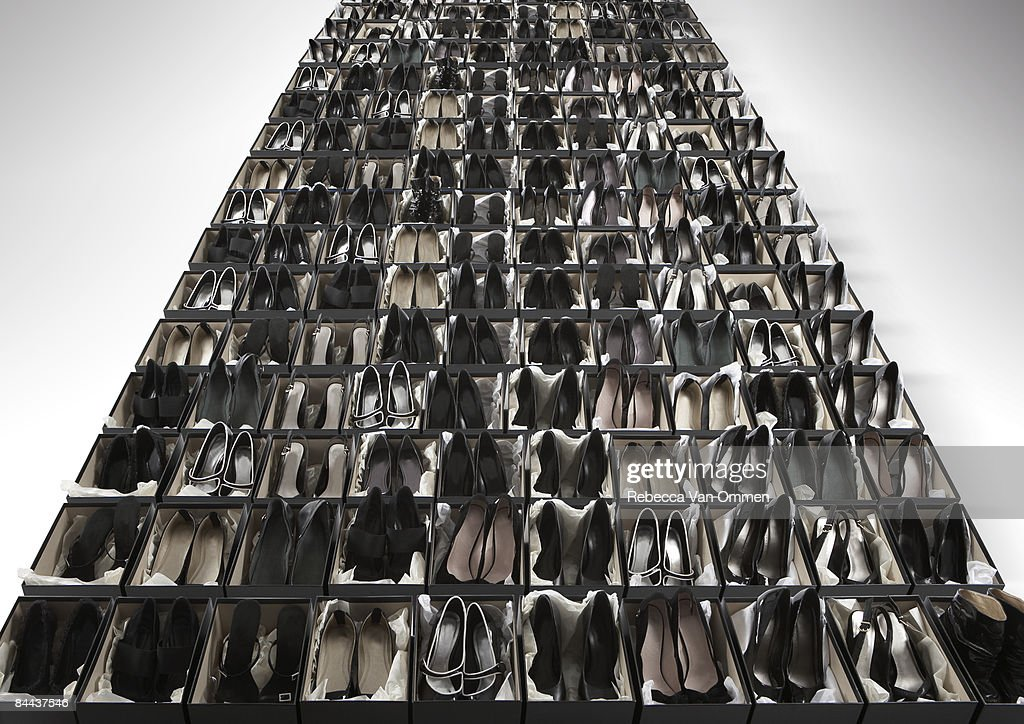 an infinite row of shoe boxes : Stock Photo